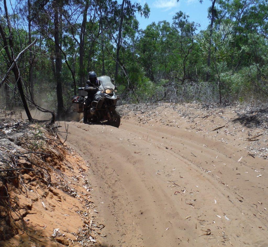 BMW rider tackling a deep sandy track, Northern Territory