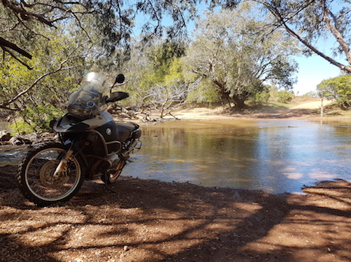 Motorbike parked by a river crossing in Kakadu National Park, Northern Territory